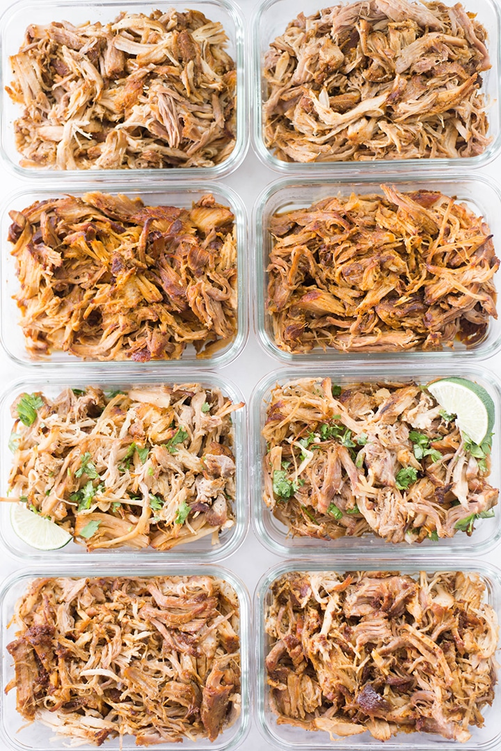View from the top of 8 meal prep containers with pulled pork. There are 2 meal prep containers for each of the pulled pork flavors.