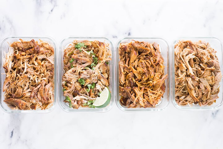 View from the top of Basic Pulled Pork, BBQ Pulled Pork, Carolina Pulled Pork, and Carnitas Pulled Pork in meal prep containers.