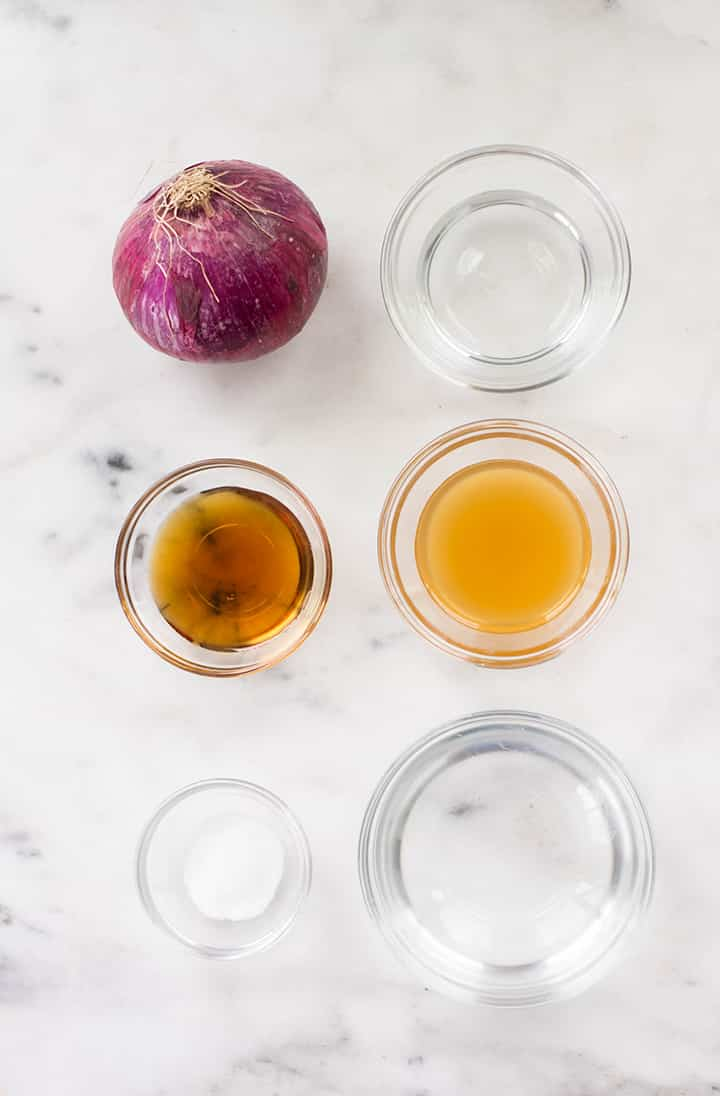 Separated ingredients for pickled onions including red onion, water, distilled white vinegar, apple cider vinegar, sea salt, and maple syrup.