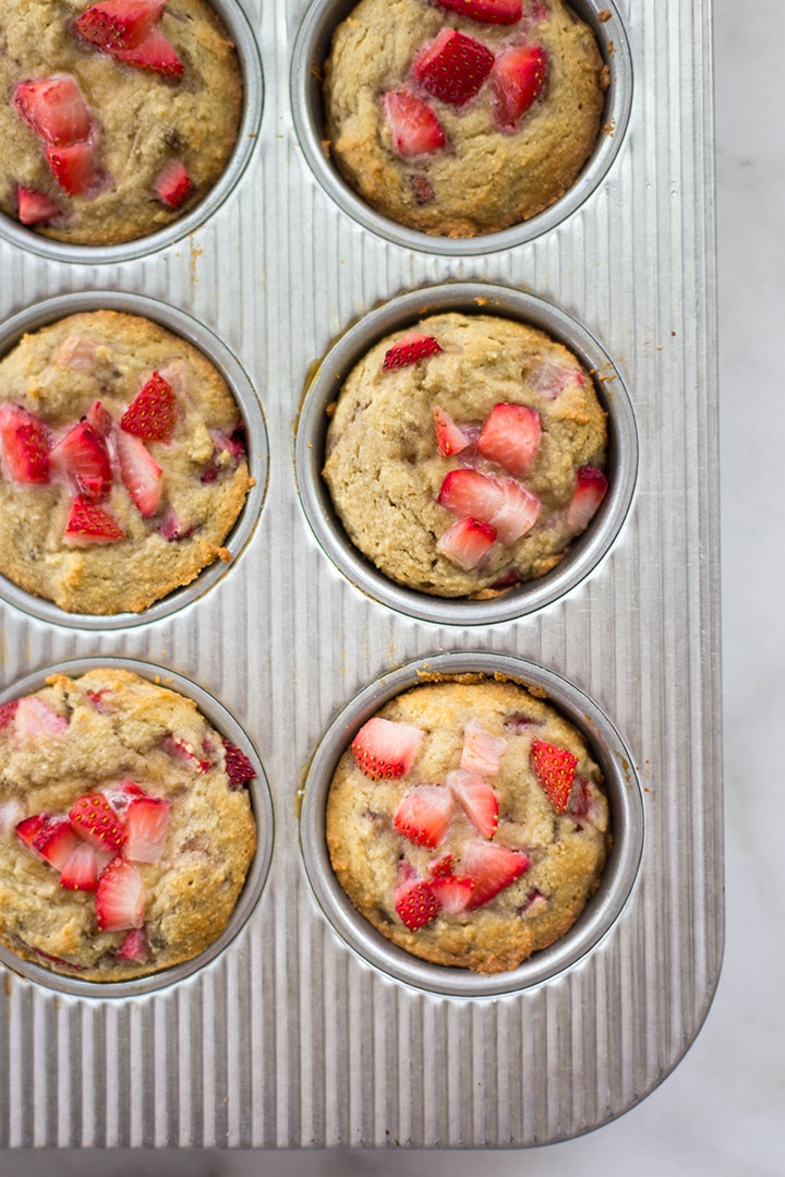 Freshly baked strawberry muffins in the muffin tin.