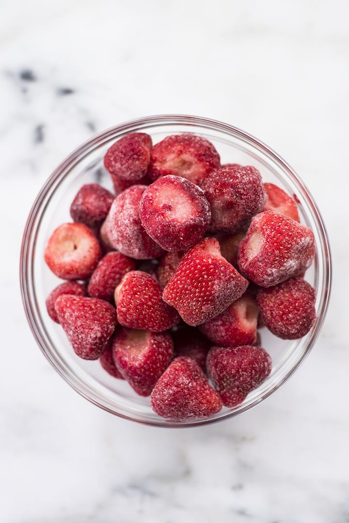 Frozen strawberries that will be turned into healthy strawberry sorbet.