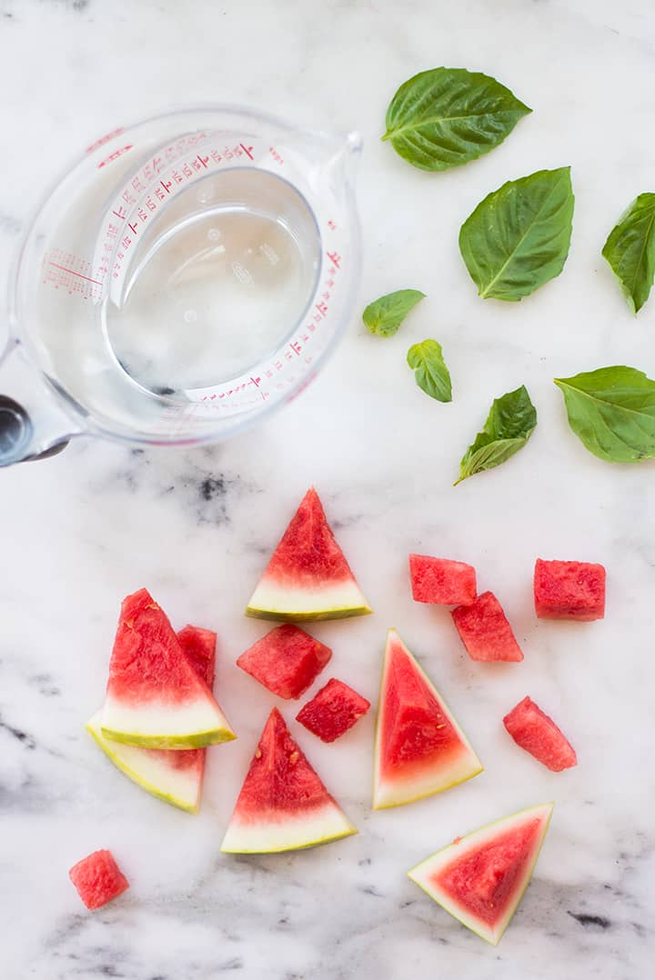 Overhead view of the three ingredients required for watermelon and basil infused water.