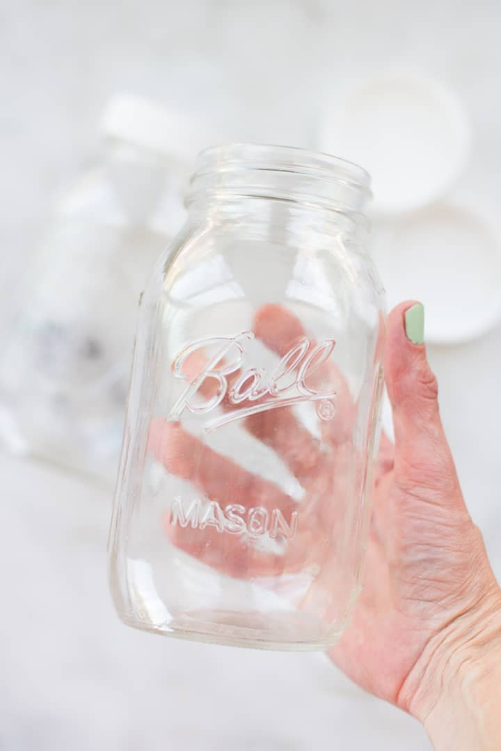 Hand holding 1 quart mason jar ready to be used for infusing water.