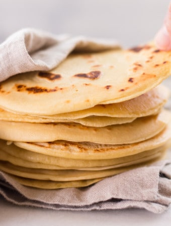 How to make delicious and easy 4-ingredient chickpea tortillas using chickpea flour, sea salt, water, and arrowroot starch. These tortillas are vegan, gluten-free, and clean-eating!