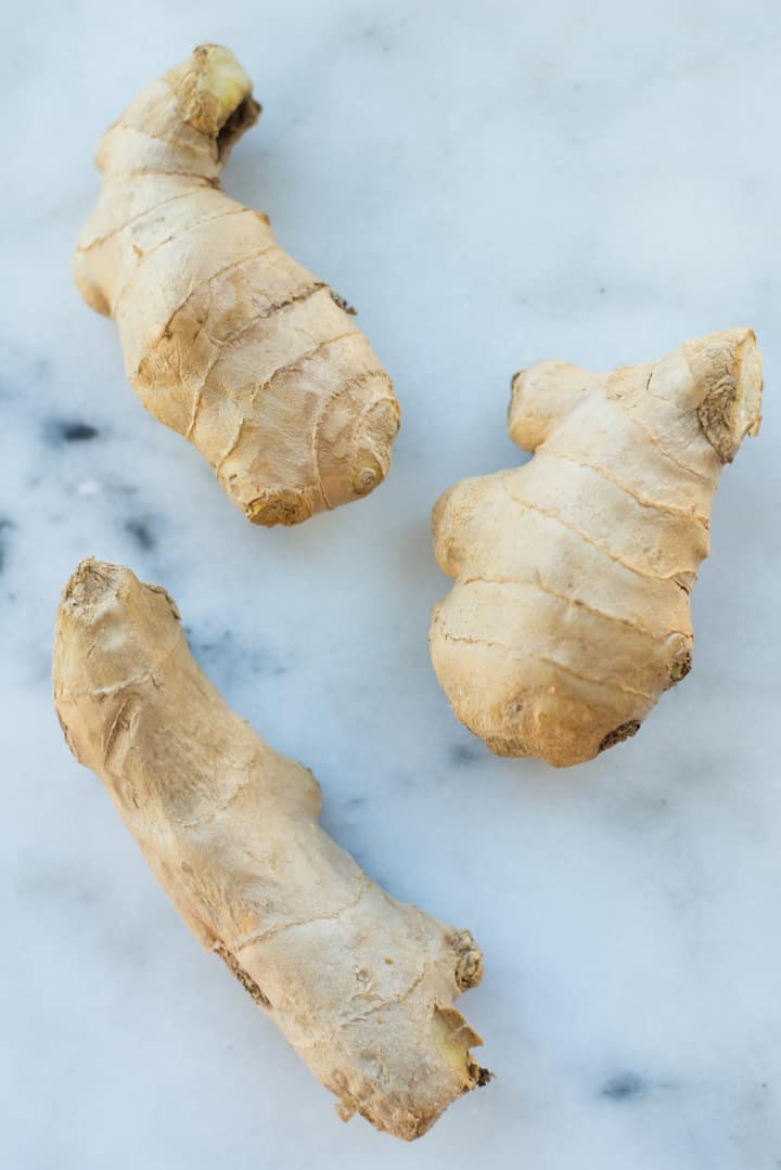 Overhead view of fresh ginger, ready to be chopped for Healthy Ginger Molasses Cookies