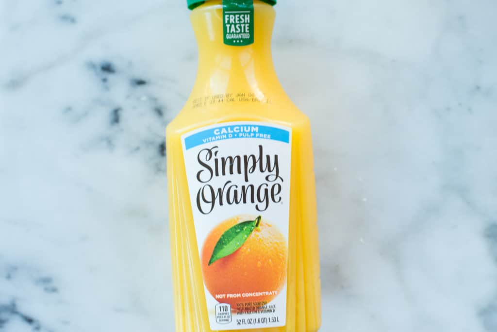 Image of a bottle of orange juice, packed with sugar and short on fiber.