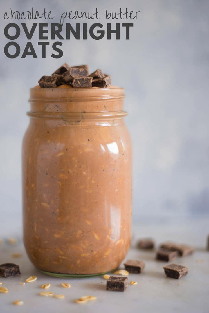 Side view image of a mason jar filled with Chocolate Peanut Butter Overnight Oats topped with chocolate chunks and ready to eat.