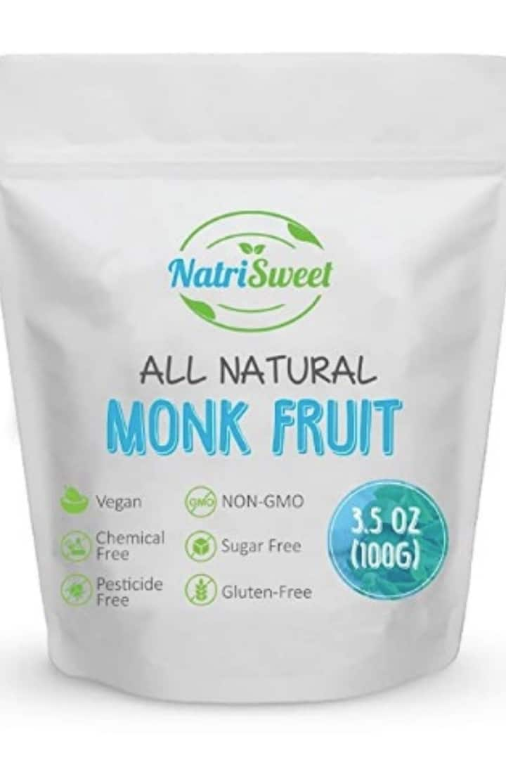 Close up image of a white bag with blue and green lettering containing all natural Monk Fruit sweetener.